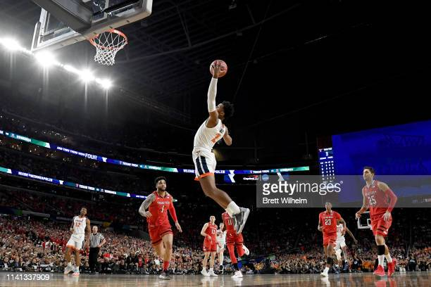 Braxton Key of the Virginia Cavaliers reaches for the ball during the first half against the Texas Tech Red Raiders in the 2019 NCAA men's Final Four...