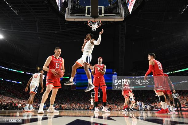 Braxton Key of the Virginia Cavaliers reacts after dunking on Matt Mooney of the Texas Tech Red Raiders during the first half in the 2019 NCAA Photos...