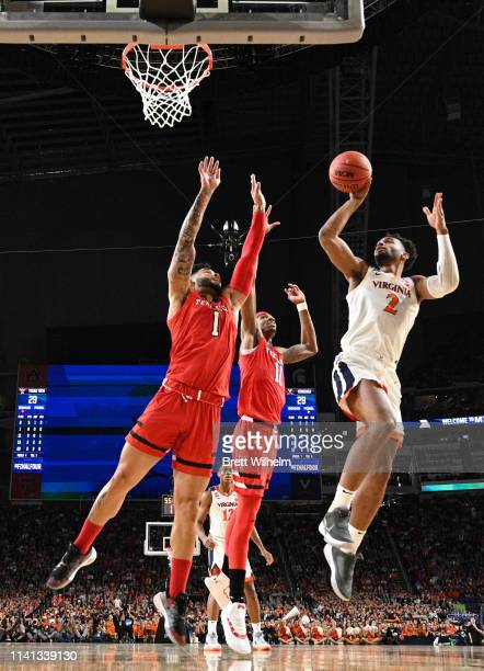 Braxton Key of the Virginia Cavaliers shoots against Brandone Francis of the Texas Tech Red Raiders during the first half in the 2019 NCAA men's...