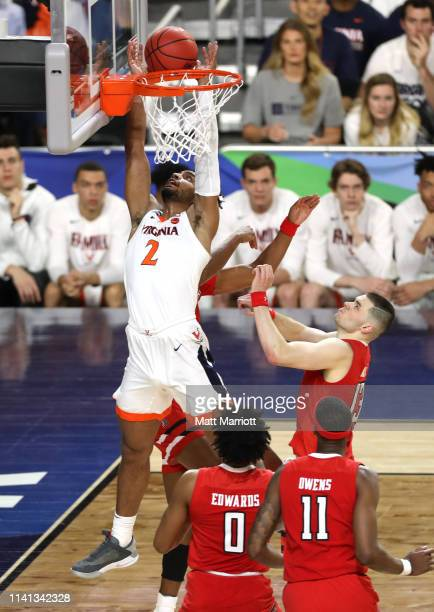 Braxton Key of the Virginia Cavaliers shoots against Matt Mooney of the Texas Tech Red Raiders during the second half in the 2019 NCAA men's Final...