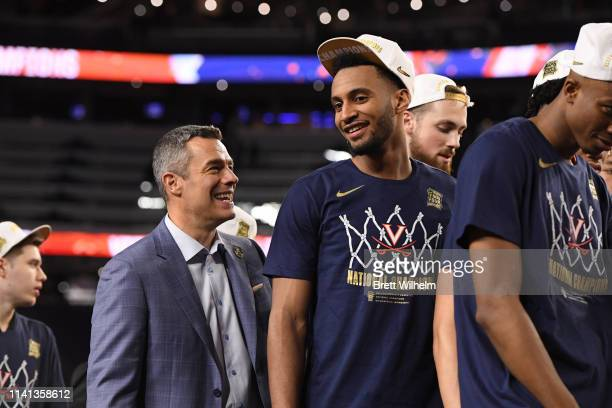 Braxton Key of the Virginia Cavaliers talks to head coach Tony Bennett of the Virginia Cavaliers after winning in the 2019 NCAA men's Final Four...