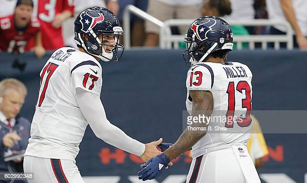 Braxton Miller celebrates Brock Osweiler of the Houston Texans touchdown pass against the Chicago Bears in the second half at NRG Stadium on...
