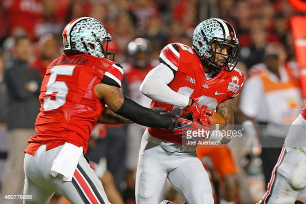 Braxton Miller hands the ball off to Corey Brown of the Ohio State Buckeyes against the Clemson Tigers during the 2014 Discover Orange Bowl at Sun...