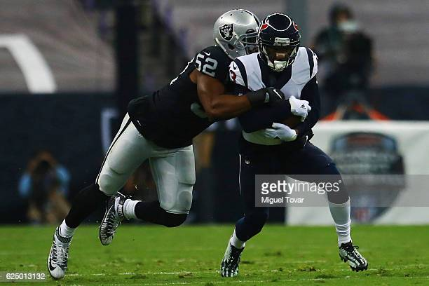 Braxton Miller of Houston Texans is tackled by Kahlil Mack of Oakland Raiders during the NFL football game between Houston Texans and Oakland Raiders...
