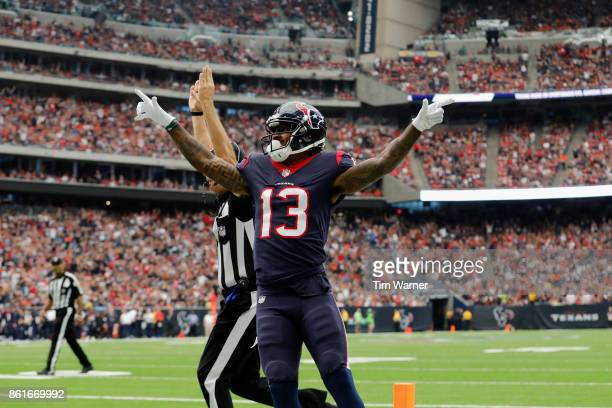 Braxton Miller of the Houston Texans celebrates after a touchdown in the second quarter against the Cleveland Browns at NRG Stadium on October 15,...