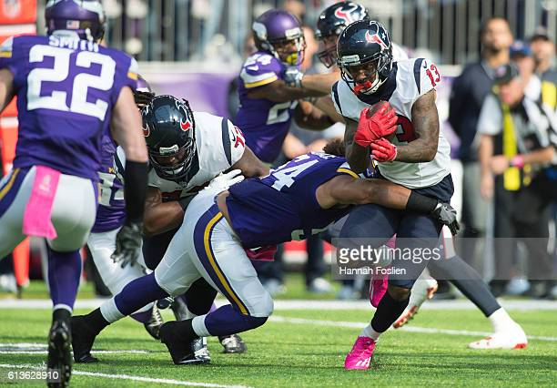 Braxton Miller of the Houston Texans is tackled by Eric Kendricks of the Minnesota Vikings during the third quarter of the game on October 9 2016 at...