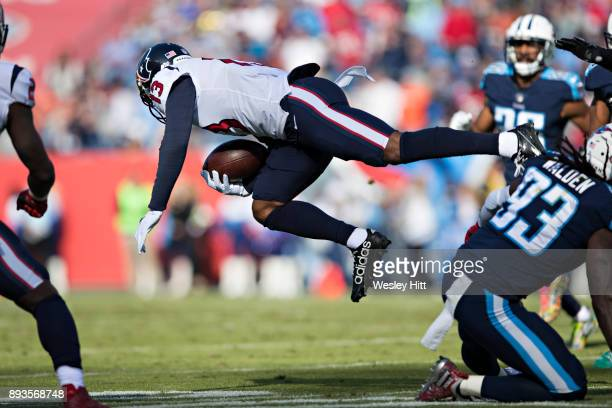 Braxton Miller of the Houston Texans is tripped up after during a game against the Tennessee Titans at Nissan Stadium on December 3 2017 in Nashville...