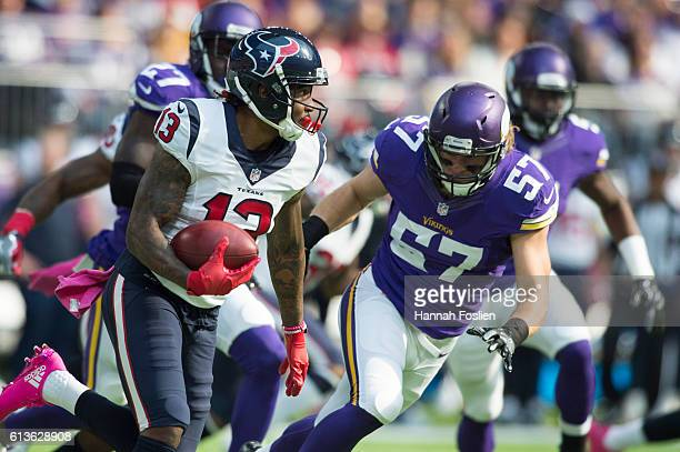 Braxton Miller of the Houston Texans runs with the ball after making a catch in front of Audie Cole of the Minnesota Vikings during the first quarter...