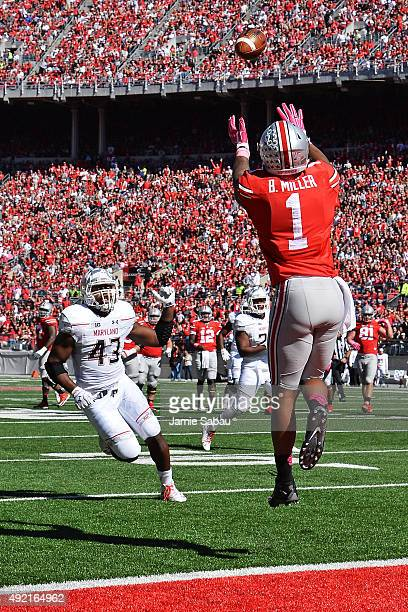 Braxton Miller of the Ohio State Buckeyes catches a 19yard touchdown pass in the second quarter as Jalen Brooks of the Maryland Terrapins closes in...