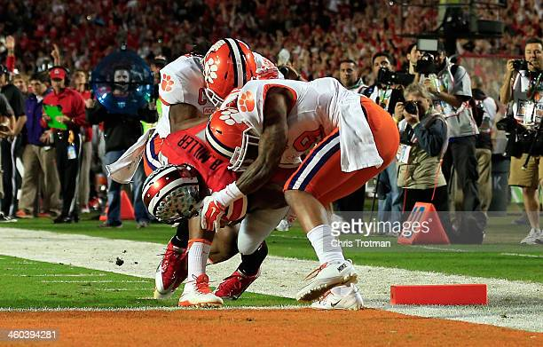 Braxton Miller of the Ohio State Buckeyes runs in for a touchdown in the first quarter against Quandon Christian and Darius Robinson of the Clemson...