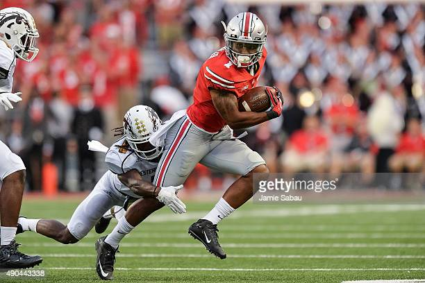 Braxton Miller of the Ohio State Buckeyes runs with the ball against the Western Michigan Broncos at Ohio Stadium on September 26, 2015 in Columbus,...