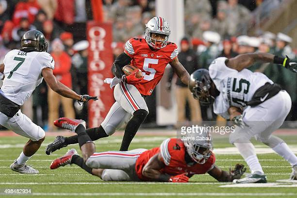 Braxton Miller of the Ohio State Buckeyes runs with the ball against the Michigan State Spartans at Ohio Stadium on November 21, 2015 in Columbus,...