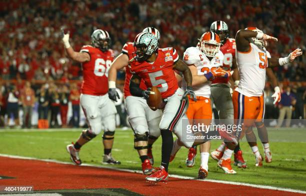 Braxton Miller of the Ohio State Buckeyes scores a touchdown late in the second quarter against the Clemson Tigers during the Discover Orange Bowl at...