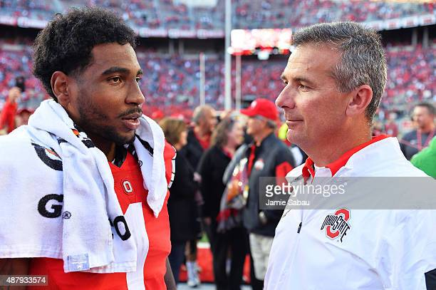 Braxton Miller of the Ohio State Buckeyes talks with Head Coach Urban Meyer of the Ohio State Buckeyes after their game against the Hawaii Rainbow...