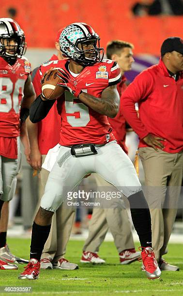 Braxton Miller of the Ohio State Buckeyes warms up prior to the Discover Orange Bowl against the Clemson Tigers at Sun Life Stadium on January 3,...