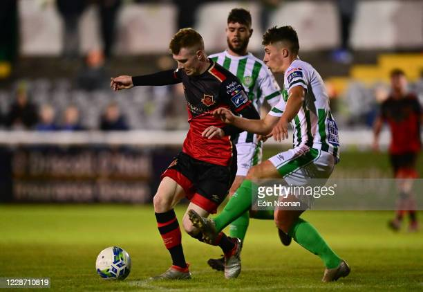 Bray , Ireland - 25 September 2020; Mark Doyle of Drogheda United in action against Dylan Barnett of Bray Wanderers during the SSE Airtricity League...