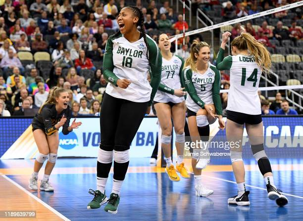 Braya Hunt of the Baylor Bears reacts after a point in the match against the Wisconsin Badgers during the Division I Women's Volleyball Semifinals...