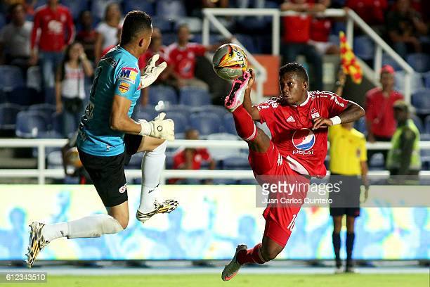 Brayan Angulo of America de Cali and Miguel Torres goalkeeper of Valledupar fight for the ball during a match between America de Cali and Valledupar...