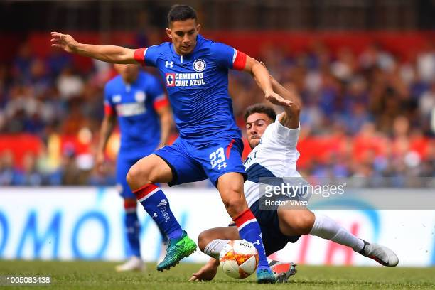 Brayan Angulo of Puebla loses the ball in the air with Edgar Mendez of Cruz Azul during the 1st round match between Cruz Azul and Puebla as part of...