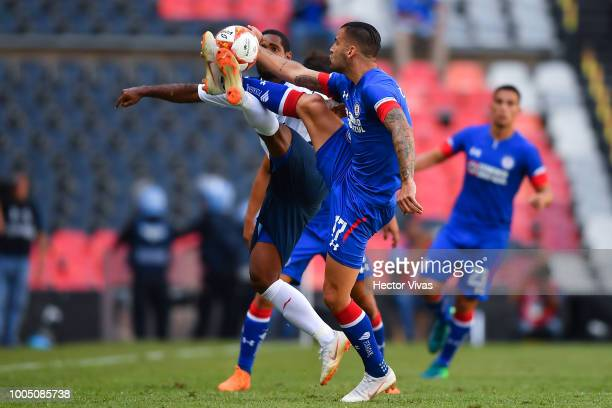 Brayan Angulo of Puebla struggles for the ball with Edgar Mendez of Cruz Azul during the 1st round match between Cruz Azul and Puebla as part of the...