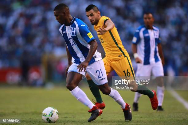 Brayan Beckeles of Honduras struggles for the ball with Aziz Behich of Australia during a first leg match between Honduras and Australia as part of...