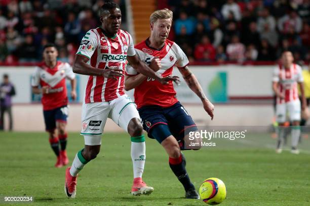Brayan Beckeles of Necaxa and Cristian Menendez of Veracruz fight for the ball during the first round match between Necaxa and Veracruz as part of...