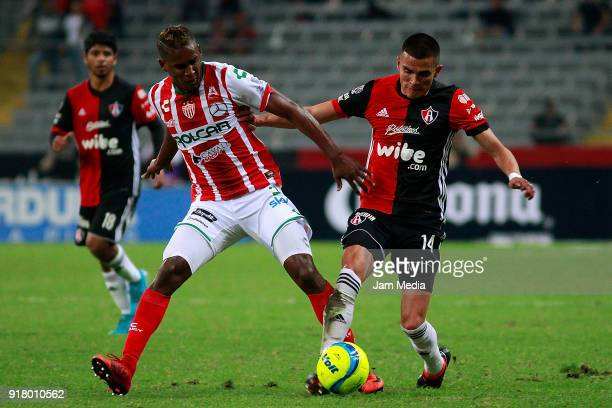 Brayan Beckeles of Necaxa fights for the ball with Luis Reyes of Atlas during the 7th round match between Atlas and Necaxa as part of the Torneo...