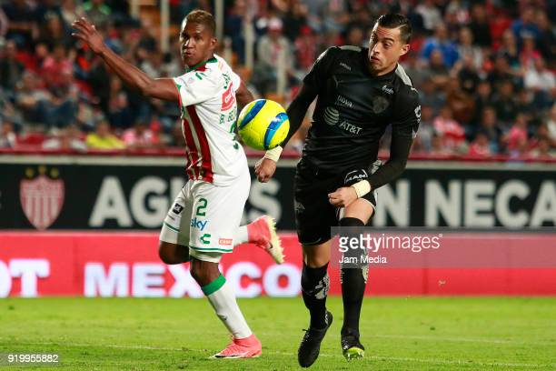 Brayan Beckeles of Necaxa fights for the ball with Rogelio Funes Mori of Monterrey during the 8th round match between Necaxa and Monterrey as part of...