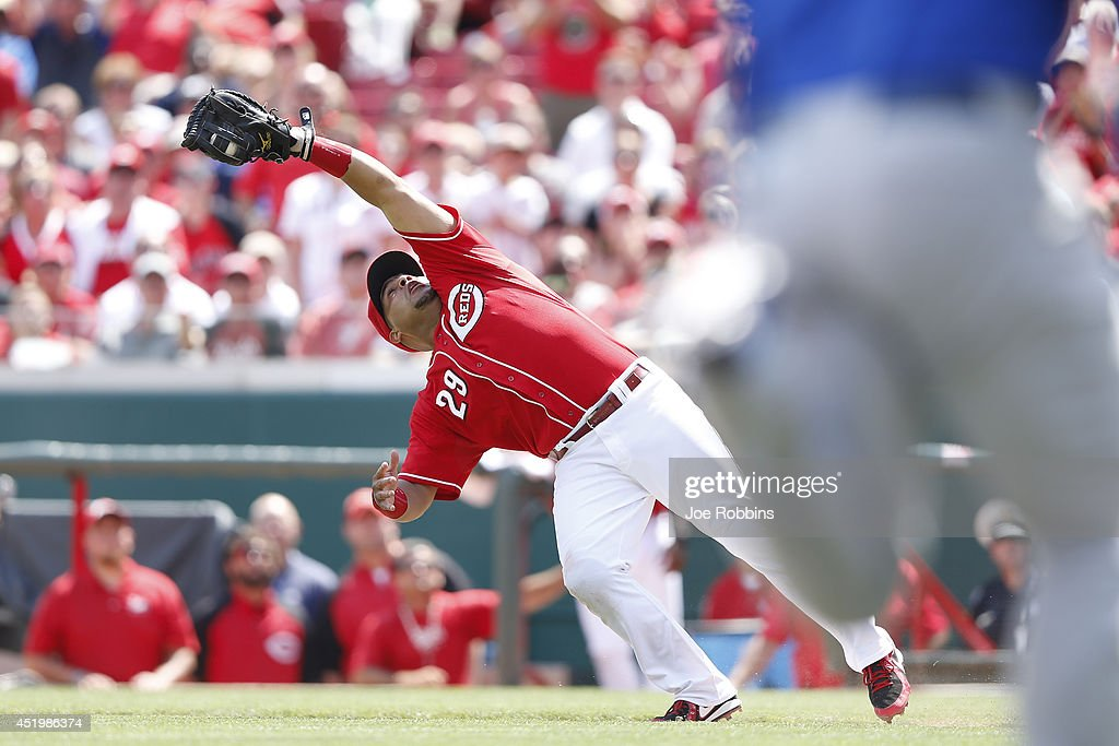 Brayan Pena #29 of the Cincinnati Reds catches an infield fly ball with the bases loaded to end the tenth inning of the game against the Chicago Cubs at Great American Ball Park on July 10, 2014 in Cincinnati, Ohio. The Cubs won 6-4 in 12 innings.