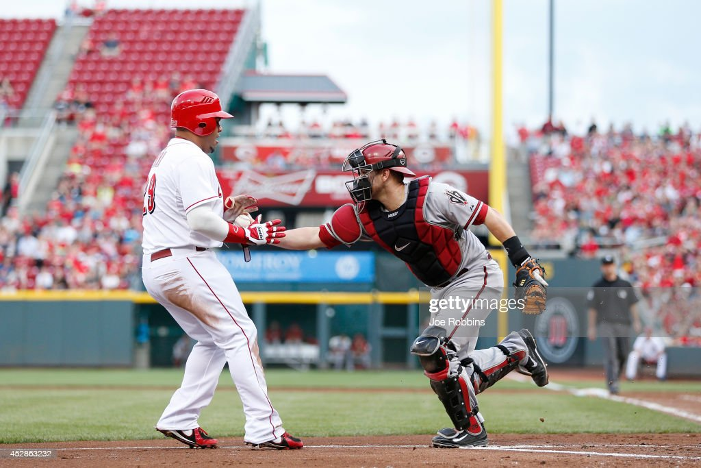 Brayan Pena #29 of the Cincinnati Reds gets tagged out at home plate by Miguel Montero #26 of the Arizona Diamondbacks in the second inning of the game at Great American Ball Park on July 28, 2014 in Cincinnati, Ohio.
