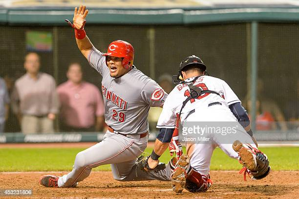 Brayan Pena of the Cincinnati Reds is tagged out at home plate by catcher Yan Gomes of the Cleveland Indians during the ninth inning at Progressive...