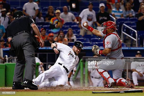 Brayan Pena of the Cincinnati Reds reacts after tagging out Casey McGehee of the Miami Marlins at home plate during the first inning of the game at...