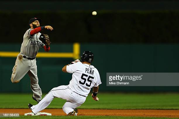 Brayan Pena of the Detroit Tigers is out on a ball hit by Austin Jackson as Dustin Pedroia of the Boston Red Sox turns the double play in the sixth...