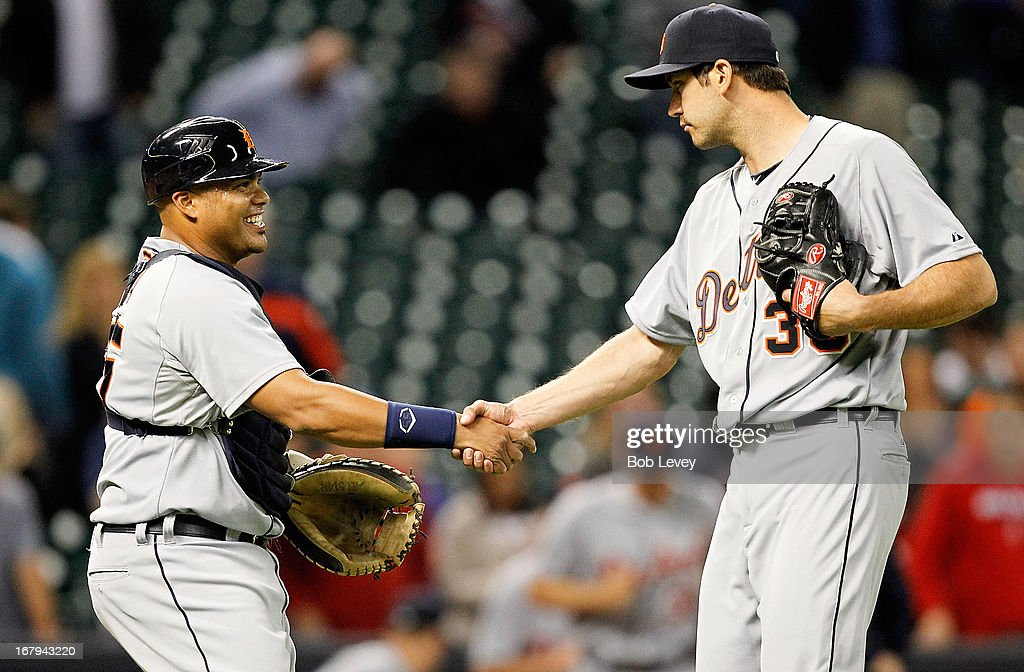 Brayan Pena #55 of the Detroit Tigers shakes hands with pitcher Luke Putkonen #36 after defeating the Houston Astros in the 14th inning 7-3 at Minute Maid Park on May 2, 2013 in Houston, Texas.