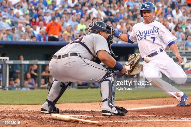 Brayan Pena of the Detroit Tigers tags out David Lough of the Kansas City Royals at the plate third inning on September 7 2013 at Kauffman Stadium in...