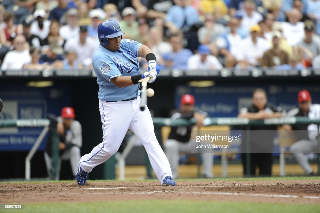Brayan Pena of the Kansas City Royals bats and breaks his bat as he hits the ball during the game against the Chicago White Sox at Kauffman Stadium in Kansas City, Missouri on Saturday, July 4, 2009. The Royals defeated the White Sox 6-4.