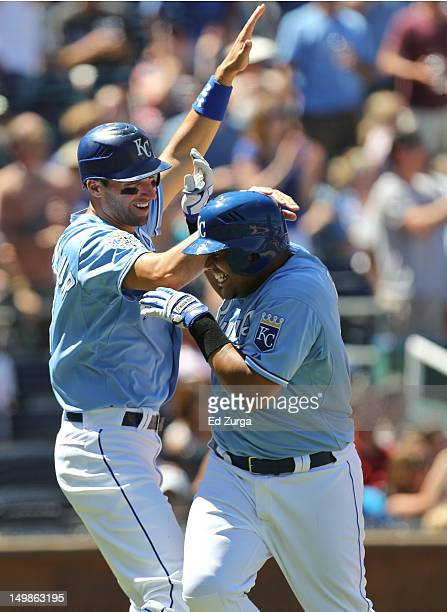 Brayan Pena of the Kansas City Royals celebrates his tworun home run with Jeff Francoeur during a game against the Texas Rangers in the sixth inning...