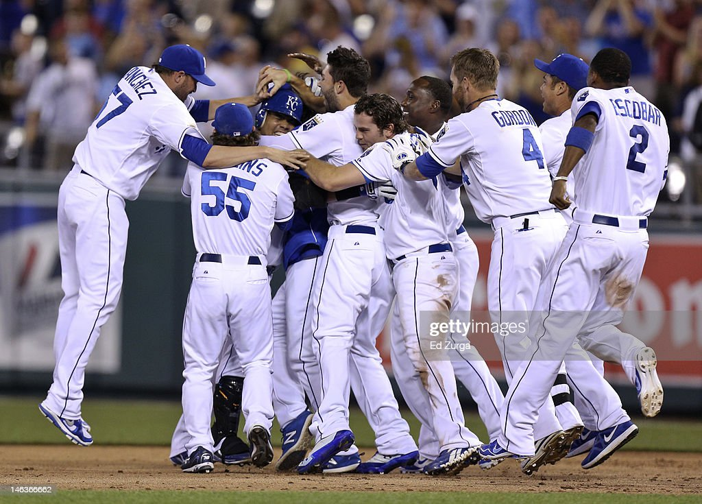 Brayan Pena #27 of the Kansas City Royals is congratulated by teammates after driving in the game-winning run during an interleague game against the Milwaukee Brewers at Kauffman Stadium on June 14, 2012 in Kansas City, Missouri. The Royals won 4-3.