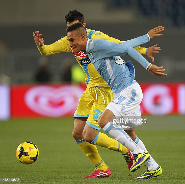 Brayan Perea of SS Lazio competes for the ball with Miguel Angel Britos of SSC Napoli during the Serie A match between SS Lazio and SSC Napoli at...