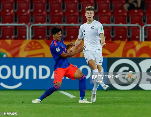 Brayan Vera of Colombia and George Stanger of New Zealand battle for the ball during the 2019 FIFA U20 World Cup Round of 16 match between Colombia...
