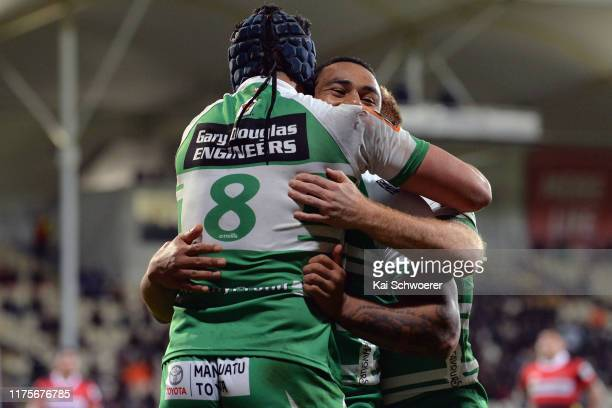 Brayden Iose of Manawatu is congratulated by Ngani Laumape of Manawatu after scoring a try during the round 7 Mitre 10 Cup match between Canterbury...
