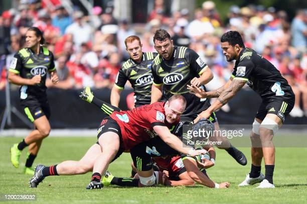 Brayden Iose of the Hurricanes is tackled by Oliver Jager of the Crusaders during the Super Rugby preseason match between the Crusaders and the...