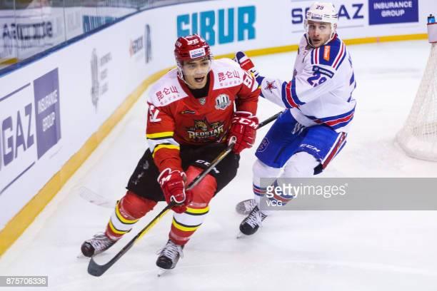 Brayden Jaw of HC Kunlun Red Star and Ilya Kablukov of SKA Saint Petersburg vie for the puck during the 2017/18 Kontinental Hockey League Regular...