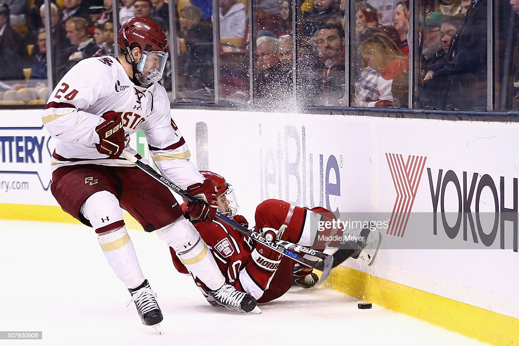 Brayden Jaw #10 of the Harvard Crimson is checked into the bards by Zach Sanford #24 of the Boston College Eagles during the third period at TD Garden on February 1, 2016 in Boston, Massachusetts. The Eagles defeat the Crimson 3-2.