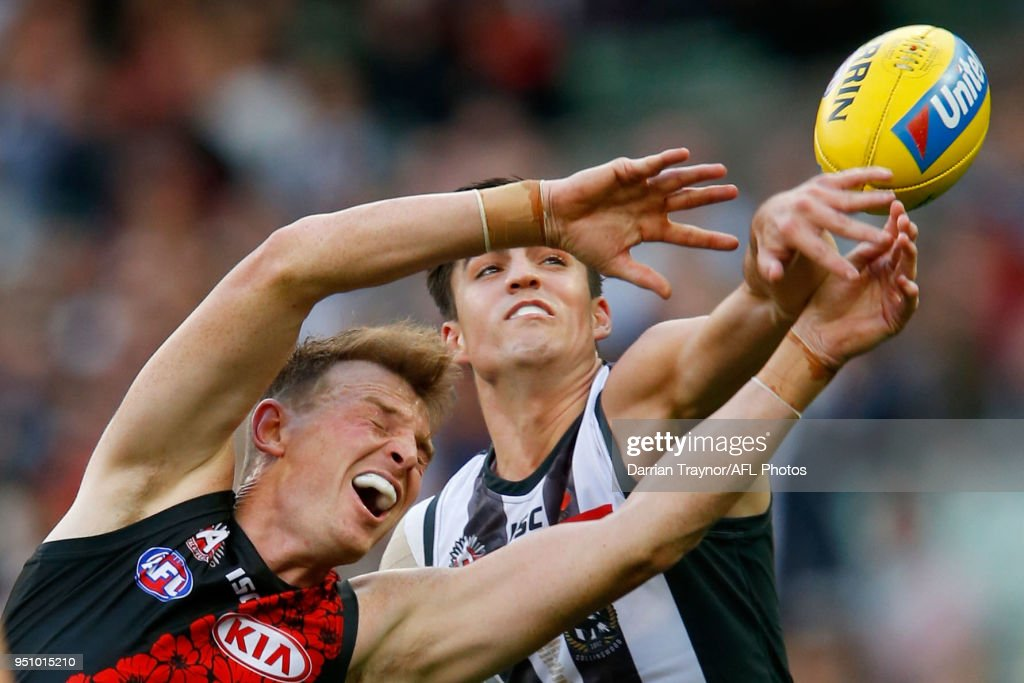 Brayden Maynard of the Magpies spoils Brendon Goddard of the Bombers during the round five AFL match between the Collingwood Magpies and the Essendon Bombvers at Melbourne Cricket Ground on April 25, 2018 in Melbourne, Australia.