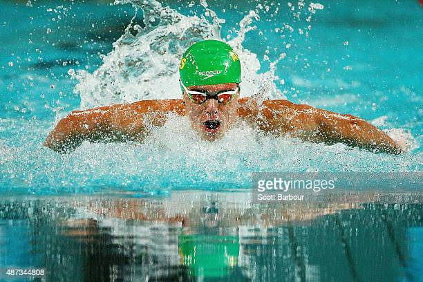 Brayden McCarthy of Australia competes in the Men's 100m Butterfly Final at the Aquatic Centre of the Tuanaimato Sports Facility on day three of the...