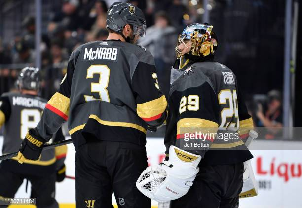 Brayden McNabb and Marc-Andre Fleury of the Vegas Golden Knights talk during a break in play during the second period against the Calgary Flames at...