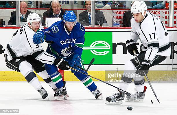 Brayden McNabb and Milan Lucic of the Los Angeles Kings combine to check Linden Vey of the Vancouver Canucks during their NHL game at Rogers Arena...
