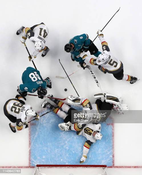 Brayden McNabb Deryk Engelland Tomas Nosek PierreEdouard Bellemare and goalie MarcAndre Fleury of the Vegas Golden Knights are able to stop Tomas...
