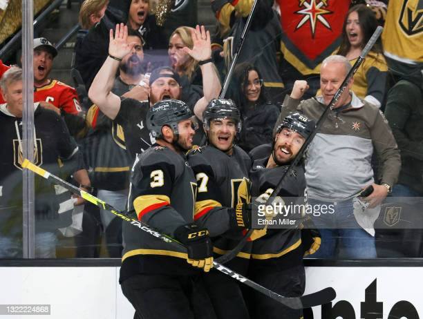 Brayden McNabb, Max Pacioretty and Chandler Stephenson of the Vegas Golden Knights celebrate Pacioretty's second-period goal against the Colorado...
